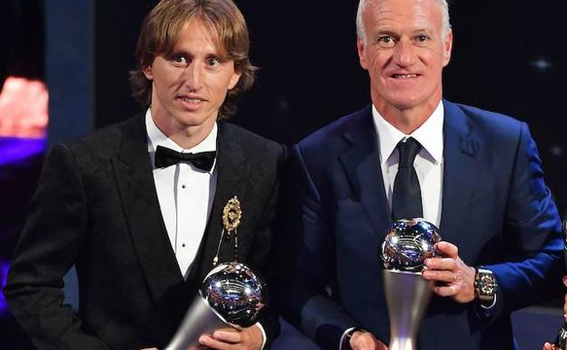Luka Modric y Didier Deschamps. /Afp